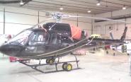 skutečný  AS 355N Ecureuil OM - IKM  v hangáru